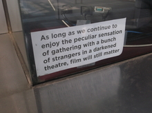 A sign posted in the window of downtown Salt Lake City's Broadway Centre Cinemas in the summer of 2011.