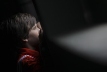 A ball boy watches watches the second round match of Arantxa Rus of The Netherlands against Virginie Razzano of France at the French Open tennis tournament in Roland Garros stadium in Paris, Thursday May 31, 2012. (AP Photo/David Vincent)