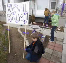 Al Hartmann  |  The Salt Lake Tribune  Friends and family of Susan Powell put purple ribbons around her home in 2010, along with signs saying that she is loved, missed and that she will be found.