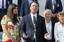 John Edwards, second from left, speaks outside a federal courthouse as his daughter Cate Edwards, left, and parents Wallace Edwards, second from right, and Bobbie Edwards, right, look on after the jury's verdict in his trial on charges of campaign corruption in Greensboro, N.C., Thursday, May 31, 2012. (AP Photo/Chuck Burton)