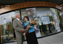 Stephen and Sandra Covey gather at the front of the newly named Covey Center for the Arts. Provo City officials announce the naming rights to the arts center along Center Street at the site that used to be the city library as the Covey Center for the Arts on Thursday named for Sandra M. Covey, a member and former Chair of the Provo Arts Council.    Photo by Francisco Kjolseth/The Salt Lake Tribune 8/23/2007