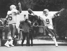 Tribune file photo BYU's Jim McMahon (9) looks to Clay Brown for celebration after a touchdown in 1980.