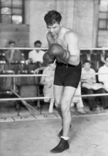 This is an August 1931 photo of former heavyweight boxing champion Jack Dempsey training in Reno, Nevada.  (AP Photo)