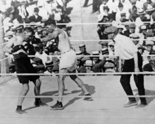 Challenger Tommy Gibbons, left, pulled back as heavyweight champion Jack Dempsey missed with a left during their title bout in Shelby, Montana, on July 4, 1923. The referee was Jim Dougherty, who then lived near Philadelphia, Pennsylvania. Gibbons, 69, died in his sleep at his St. Paul, Minnesota, November 19. (AP Photo)