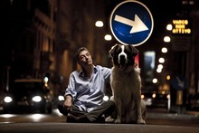 Antonio Carloni  |  Zeitgeist Films Gianni (Gianni di Gregorio, center) walks his sexy neighbor's dog, in a scene from the comedy