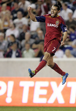 Real Salt Lake's Fabian Espindola (7) celebrates his first of two first-half goals against the New York Red Bulls in a soccer game at Red Bull Arena in Harrison , N.J., Wednesday, Sept. 21, 2011. (AP Photo/Rich Schultz)