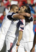 Real Salt Lake forward Fabian Espindola, center, celebrates his goal with teammates Alvaro Saborio, left, and Ned Grabavoy during the first half of an MLS Western Conference semifinals soccer game against FC Dallas, Saturday, Oct. 30, 2010, in Frisco, Texas. (AP Photo/LM Otero)