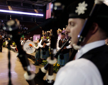 Trent Nelson  |  The Salt Lake Tribune The Utah Pipe Band performs during the Processional at Westminster College's Commencement Saturday, June 2, 2012 at the Maverik Center in West Valley City.