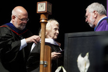 Trent Nelson  |  The Salt Lake Tribune Noreen Rouillard, center, receives an honorary degree from Westminster College Provost Dr. James Seidelman, left, and President Dr. Michael Bassis at Commencement Saturday, June 2, 2012 at the Maverik Center in West Valley City.
