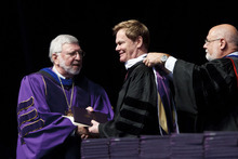 Trent Nelson  |  The Salt Lake Tribune Bruce Bastian, center, receives an honorary degree from Westminster College Provost Dr. James Seidelman, right, and President Dr. Michael Bassis at Commencement Saturday, June 2, 2012 at the Maverik Center in West Valley City.