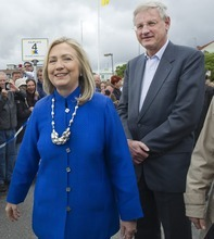 US Secretary of State Hillary Rodam Clinton, left, and Swedish Foreign Minister Carl Bildt  at Vaxholm Island near Stockholm, Sweden, Sunday June 3, 2012. Clinton and Bildt took a boat from Stockholm to the 16th Century fortress town to pick up Swedish Defense Minister Karin Enstrom (not shown) for a meeting on the boat trip back to the city. (AP Photo/Maja Suslin)  SWEDEN OUT