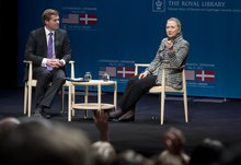 US Secretary of State Hillary Clinton speaks alongside television host Johannes Langkilde during a town hall forum with students in Copenhagen, Denmark, Thursday May 31, 2012. Clinton said Thursday that every day of slaughter in Syria is strengthening the case for tougher international action, yet stressed that military intervention would require support from the world community and Syria's ally Russia. (AP Photo / Saul Loeb, Pool)