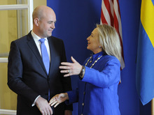Swedish Prime Minister Fredrik Reinfeldt, left, greets US Secretary of State Hillary Rodham Clinton as she arrives for meetings at Rosenbad in Stockholm, Sweden, Sunday, June 3, 2012. (AP Photo/Erik Martensson) SWEDEN OUT