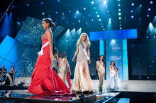 Walking the runway are Miss Mississippi USA 2012, Myverick Rashea Garcia, at left in Red; Miss Missouri USA 2012, Katie Kearney; Miss Montana USA 2012, Autumn Marie Muller; and Miss Nebraska USA 2012, Amy Spilker competing in her choice evening gown during the 2012 Miss USA Presentation Show on Wednesday, May 30, 2012 in Las Vegas, Nevada. The 2012 MISS USA Pageant will air LIVE on NBC June 3 at 9:00 p.m. EDT.(AP Photo/Darren Decker, Miss Universe Organization)