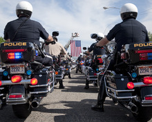 Michael Mangum  |  Special to the Tribune  Police and state troopers take to the street at the beginning of the 61st Annual Wendover MDA Ride on State Street near the Harley-Davidson of Salt Lake City shop on Sunday, June 3, 2012. Joe Timmons, the shop's owner, estimates that over 2000 bikers participated in the ride, which is geared toward raising funds for the Muscular Dystrophy Association in Utah.