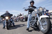 Michael Mangum  |  Special to the Tribune  Bikers take to the street at the beginning of the 61st Annual Wendover MDA Ride on State Street near the Harley-Davidson of Salt Lake City shop on Sunday, June 3, 2012. Joe Timmons, the shop's owner, estimates that over 2000 bikers participated in the ride, which is geared toward raising funds for the Muscular Dystrophy Association in Utah.