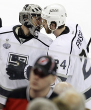 Los Angeles Kings' Jonathan Quick, left, and teammate Colin Fraser greet one another after winning Game 2 of the NHL hockey Stanley Cup finals against the New Jersey Devils, Saturday, June 2, 2012, in Newark, N.J. The Kings won 2-1. (AP Photo/Kathy Willens)