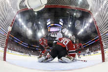 New Jersey Devils goalie Martin Brodeur (30) and Los Angeles Kings' Dustin Penner react after Kings' Jeff Carter scored the game-winning goal during the overtime period of Game 2 of the NHL hockey Stanley Cup, Saturday, June 2, 2012, in Newark N.J. The Kings won the game 2-1. (AP Photo/Bruce Bennett, Pool)