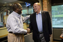 Former Republican Presidential candidate Herman Cain shakes hands with news talk radio host Neal Boortz after he was announced as Boortz's replacement following Boortz's retirement announcement during his morning show at News-Talk WSB AM750 in Atlanta, Monday, June 4, 2012. Cain will replace Boortz full-time following inauguration day, January 21, 2013. (AP Photo/Paul Abell)