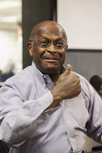 Former Republican Presidential candidate Herman Cain is introduced as the replacement radio host for Neal Boortz during his morning show at News-Talk WSB AM750 in Atlanta on Monday, June 4, 2012. Cain will replace Boortz full-time following inauguration day, Jan. 21, 2013. (AP Photo/Paul Abell)