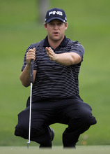 Daniel Summerhays lines up his putt on the seventh hole during the second round of the Memorial golf tournament at the Muirfield Village Golf Club in Dublin, Ohio, Friday, June 1, 2012. (AP Photo/Tony Dejak)