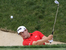 Daniel Summerhays hits out of a sand trap during the first round of the Memorial golf tournament at the Muirfield Village Golf Club in Dublin, Ohio, Thursday, May 31, 2012. (AP Photo/Tony Dejak)
