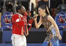 Will.I.am and Jessie J perform at the Queen's Jubilee Concert in front of Buckingham Palace, London, Monday, June 4, 2012. The concert is a part of four days of celebrations to mark the 60 year reign of Britain's Queen Elizabeth II. (AP Photo/Joel Ryan)