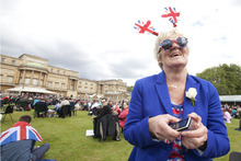 CORRECTING SPELLING OF ALNWICK - Diane Dourish from Alnwick in the north of England enjoys the special picnic in the grounds of Buckingham Palace prior to the Queen's Diamond Jubilee celebration concert in London, Monday, June 4, 2012. (AP Photo/Alastair Grant, Pool)