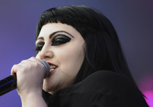 In this photo made available Saturday, June 2, 2012, singer of the US band Gossip, Beth Ditto, performs on stage during the music festival