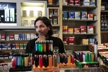 Kadir Anlayisli stands behind the counter of the internet cafe in the district of Neukoelln in Berlin, Germany, Monday, June 4, 2012, where he recognized Luka Rocco Magnotta. Kadir Anlayisli  who works in the after hours liqueur and tobacco shop with internet cafe, called a police man from outside saying he recognized the suspect person. Magnotta is wanted by Canadian authorities on first-degree murder and other charges. He is suspected of killing Jun Lin  a 33-year-old Chinese university student he dated and mailing Lin's body parts to Canadian political parties. (AP Photo/Markus Schreiber)