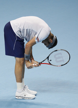 Mardy Fish of the U.S. hits the ground with his racquet after losing a point during their round robin singles tennis match against Jo-Wilfried Tsonga of France at the ATP World Tour Finals at O2 Arena in London, Tuesday, Nov. 22, 2011.  (AP Photo/Kirsty Wigglesworth)
