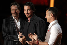 Gary Oldman, from left, Christian Bale, Joseph Gordon-Levitt are seen onstage at the MTV Movie Awards on Sunday, June 3, 2012, in Los Angeles. (Photo by Matt Sayles/Invision/AP)