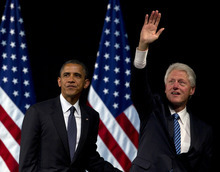 President Barack Obama and former President Bill Clinton stand together on stage at the end of a campaign event at the New Amsterdam Theatre, Monday, June 4, 2012, in New York. (AP Photo/Carolyn Kaster)