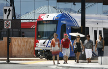 Scott Sommerdorf  |  Tribune File Photo A family on its way to shop across the street at the Valley Fair Mall passes by a TRAX train last year as it leaves the West Valley Central Station, 2750 W. 3590 South.