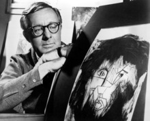 This Dec. 8, 1966 file photo shows science fiction writer Ray Bradbury looks at a picture that was part of a school project to illustrate characters in one of his dramas in Los Angeles. Bradbury, who wrote everything from science-fiction and mystery to humor, died Tuesday, June 5, 2012 in Southern California. He was 91. (AP Photo, file)