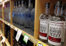 Bottles of Ogden's Own Distillery Five Wives Vodka are stocked in May at a state liquor store in Salt Lake City. After a law professor in Washington said he can't swallow Idaho''s decision not to approve a vodka that makes a cheeky reference to polygamy and threatened a lawsuit, the state reconsidered its ban on selling the vodka. (AP Photo/Brian Skoloff, File)