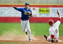 Chris Detrick  |  The Salt Lake Tribune Bingham's Brady Lail (3) forces out Spanish Fork's Kayden Porter (9) at second base during the game at Spanish Fork High School Thursday March 29, 2012. Bingham won the game 4-0.