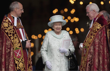Britain's Queen Elizabeth II departs St Paul's Cathedral, London  with the Dean of St Paul's David Ison, left, following a service of thanksgiving on the last day of the Queen's Diamond Jubilee celebrations in London, Tuesday, June  5, 2012. Crowds cheering
