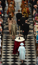 Britain's Queen Elizabeth II, foreground centre, arrives inside St Paul's Cathedral for a service of thanksgiving during Diamond Jubilee celebrations on Tuesday  June 5, 2012 in London. Crowds cheering