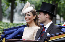 Britain's Prince William and his wife Kate, Duchess of Cambridge take an open top carriage ride through the streets of London after a Diamond Jubilee Luncheon given for The Queen, Tuesday June 5, 2012 . Crowds cheering