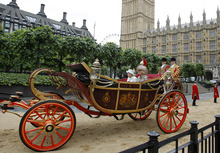 Britain.s Queen Elizabeth II  travels by carriage to Buckingham Palace with Camilla, the Duchess of Cornwall  after a lunch at Westminster Hall in London Tuesday  June 5, 2012.   Crowds cheering