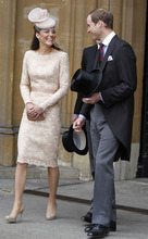 Britain's Prince William and his wife Kate Duchess of Cambridge  leave Westminster Hall in London after a Diamond Jubilee Luncheon given for The Queen Tuesday June 5, 2012 . Crowds cheering