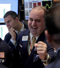 Getco Securities traders Philip Finale, left, and its floor official Peter Giacchi, right, work on the floor of the New York Stock Exchange on Wednesday, June 6, 2012.  A 200-point charge Wednesday turned the Dow Jones industrial average positive for the year following a dismal stretch in May  (AP Photo/Bebeto Matthews)