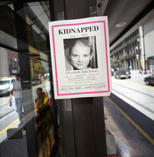 Two weeks following the kidnapp of Elizabeth Smart few answers have developed as posters of the missing girl have been put up all over the city.  Francisco Kjolseth/The Salt Lake Tribune      06/18/2002