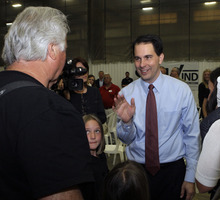 Gov. Scott Walker greets employees at Steelwind Industries in Oak Creek, Wis. on Wednesday, June 6, 2012.  Walker won a contentious recall election against Milwaukee Mayor Tom Barrett. The recall capped a bitter fight between Walker supporters and public sector unions and labor groups angered by cuts to collective bargaining that the governor advanced.(AP Photo/Milwaukee Journal-Sentinel, John Klein)