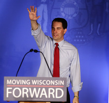 FILE - In this June 5, 2012 file photo, Wisconsin Gov. Scott Walker waves at his victory party in Waukesha, Wis. Walker's definitive victory in Wisconsin's recall election is already reverberating in other state capitols, exposing unions' diminished political muscle, vulnerability to attacks from the right and incapacity to retaliate.  (AP Photo/Morry Gash, File)