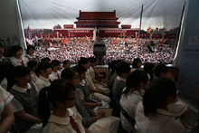 Students watch a video footage of the crackdown of the June 4, 1989 pro-democracy movement in Beijing's Tiananmen Square at the June 4 Memorial Museum run by pro-democracy activists in Hong Kong Monday, June 4, 2012 to commemorate the 23rd anniversary of the bloodshed. (AP Photo/Vincent Yu)