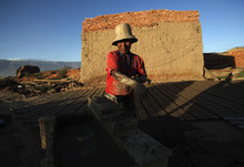 A brick maker works to make handmade bricks in Cochabamba, Bolivia, Tuesday, June 5, 2012. Brick makers charge $15 US dollars for 1,000 bricks, and in one week are able to make 6,000 bricks, according to workers. (AP Photo/Juan Karita)