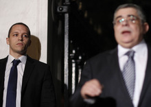 In this picture taken on May 13, 2012 at the Presidential Palace in Athens the spokesman of the extreme-right Golden Dawn party, Ilias Kasidiaris, left, escorts his leader Nikolaos Michaloliakos during a visit to the Greek President. The spokesman of the extreme-right Golden Dawn party, after trading insults of