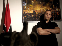 In this picture taken on April 25, 2012 at the headquarters of the extreme far-right Golden Dawn party, Ilias Kasidiaris poses for a picture. The spokesman of the extreme-right Golden Dawn party, after trading insults of
